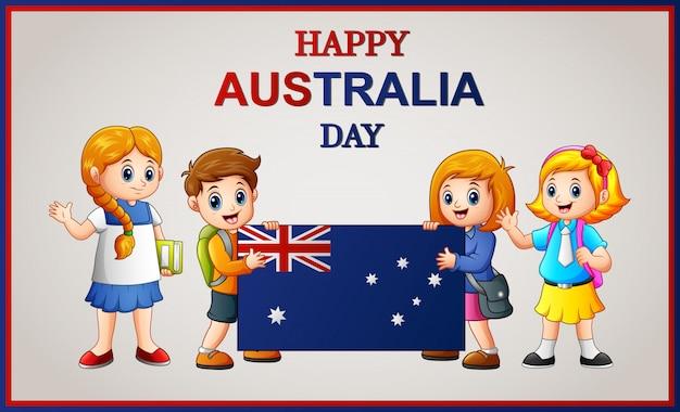 Niños felices sosteniendo una bandera en el día de australia