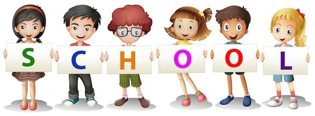 Niños formando las letras de la escuela
