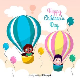 Niños en globos aerostáticos fondo dibujado