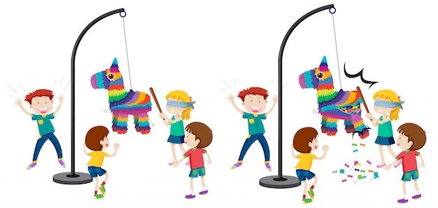 Niños golpeando juego de piñata