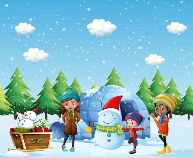 Niños con iglú y muñeco de nieve en invierno.
