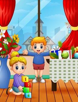 Niños jugando en casa el día de navidad.