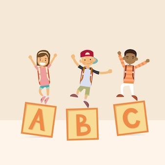 Niños en letras cubo escuela estudio alfabeto educación
