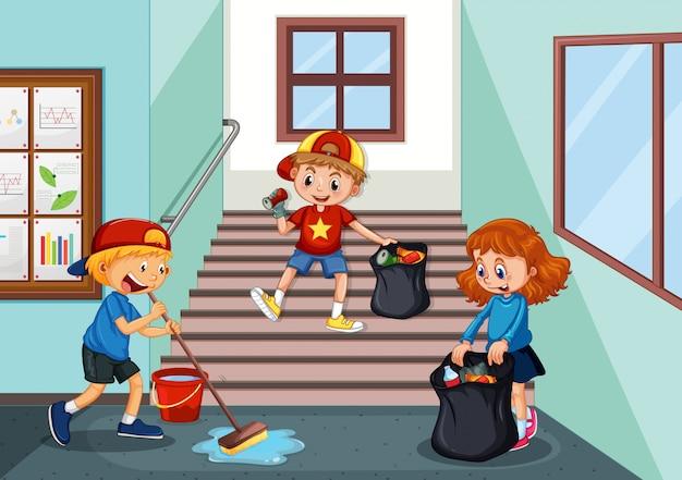 Niños limpiando el pasillo de la escuela.
