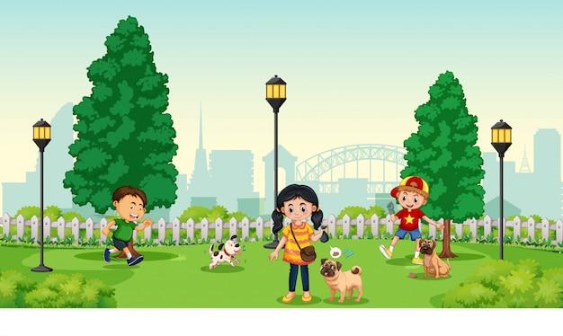 Niños con mascota en el parque.