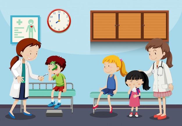 Niños y médicos en clínica.