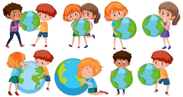Niños y niñas felices sosteniendo la tierra sobre fondo blanco.