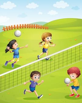 Niños y niñas jugando voleibol en el parque