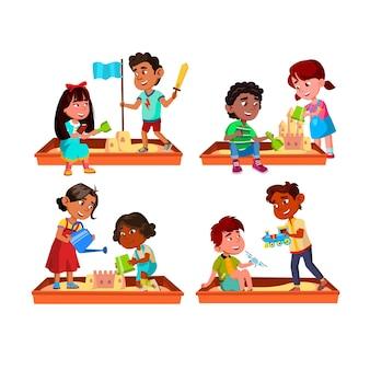 Niños niño y niña jugando en el juego de caja de arena