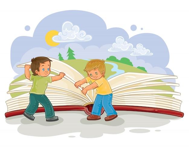 Los niños pequeños dan vuelta a páginas gran libro