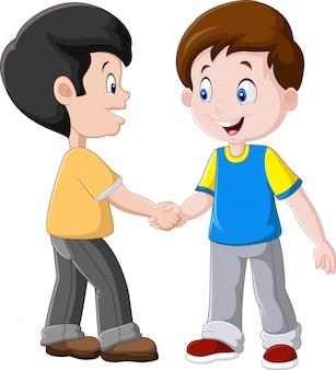 Niños pequeños estrecharme la mano