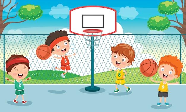 Niños pequeños jugando baloncesto afuera