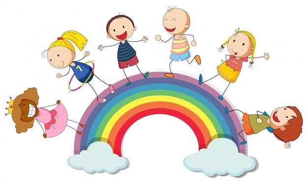 Niños de pie en el arco iris