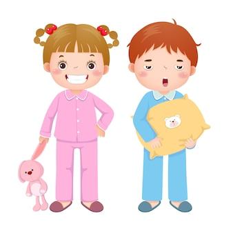 Niños en pijama y preparándose para dormir.
