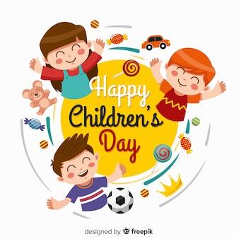 Niños planos del día del niño con juegos y dulces