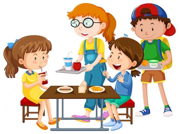 Niños que tienen comida en la mesa