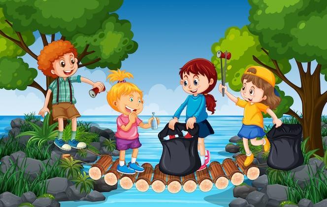 Niños recogiendo basura al lado del río