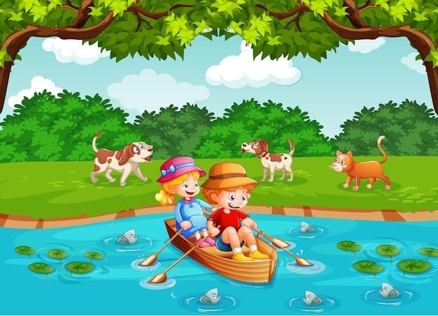 Los niños remar en el bote en la escena del parque del arroyo.