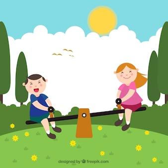 Niños sonrientes jugando en un balancín