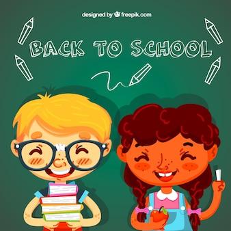 Niños sonrientes con libros y manzana