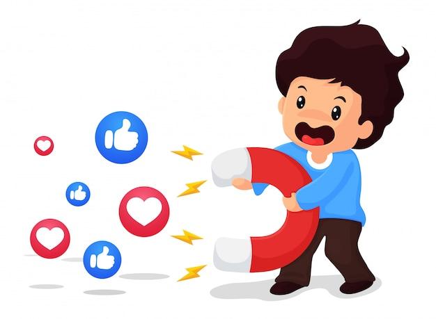 Los niños sostienen imanes grandes, la idea de atraer espectadores en las redes sociales