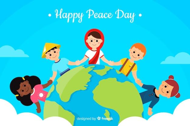 Niños tomados de la mano alrededor de la palabra fondo del día de la paz