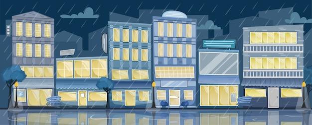 Noche lluviosa paisaje de la ciudad. calle con casas luminosas, letreros, árboles y bancos.