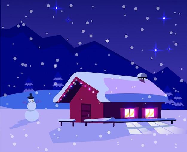 Noche de navidad paisaje nevado con una pequeña casa con ventanas iluminadas decoradas con una guirnalda y un muñeco de nieve.