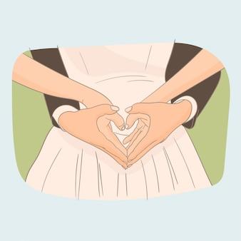 Novia y novio que hacen el corazón por las manos