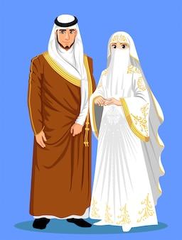Novias de arabia saudita con ropa marrón y blanca.