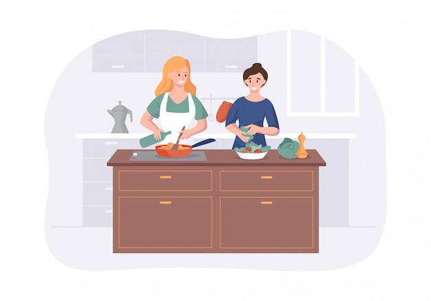 Novias pareja cocinando en la mesa de la cocina. preparación de comida de dos chicas para cenar juntos.