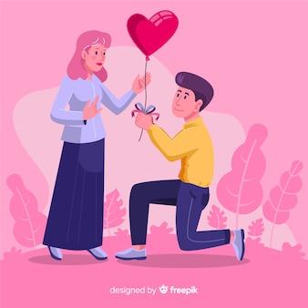 Novio dando a su novia un globo de corazón