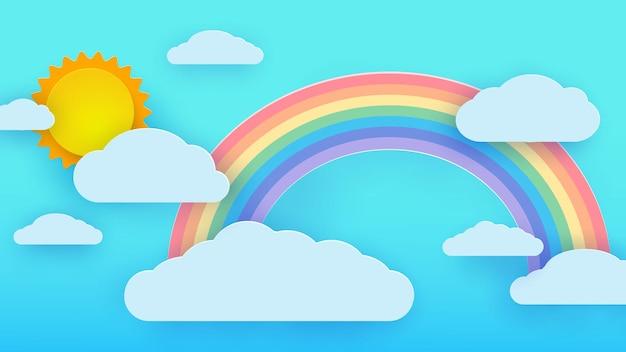 Nubes contra un cielo azul con el sol y un arco iris.
