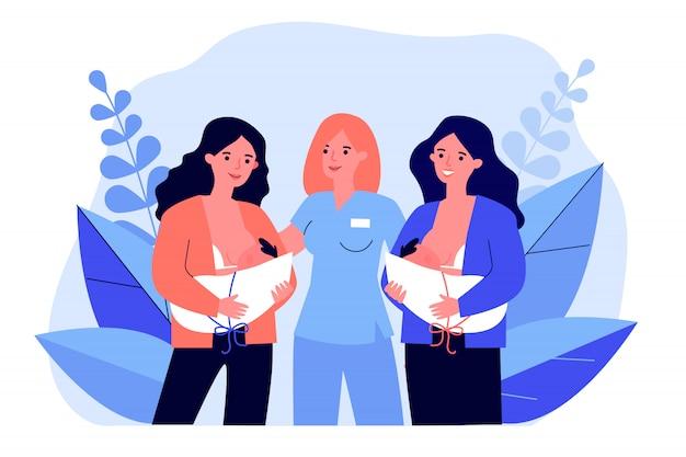 Nuevas madres alimentando bebés en la clínica de maternidad