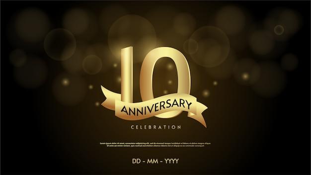 Número de celebración de aniversario con una cinta dorada.
