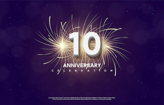 El número de celebración de aniversario con el número 10 es blanco con fuegos artificiales detrás.