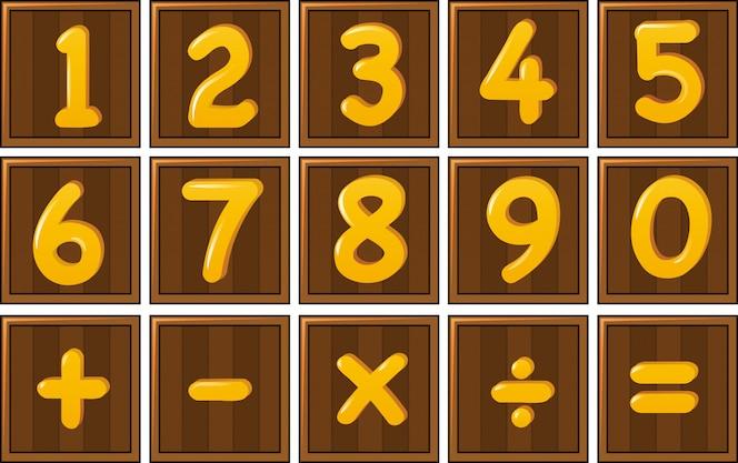Número uno a cero y signos de matemáticas en tableros de madera