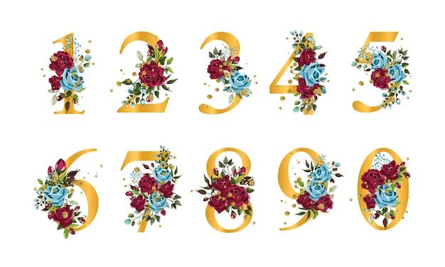Números florales dorados con flores a bordo de hojas de rosas azul marino y oro salpicado