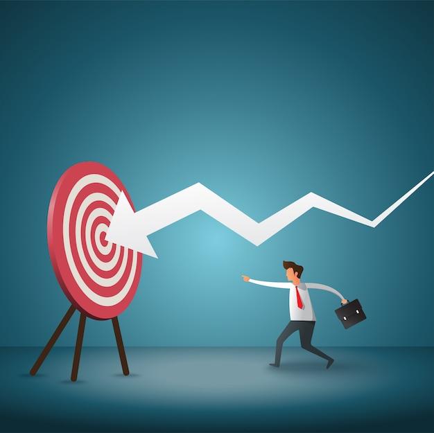 Objetivo comercial y estrategia. empresario lanzando dardos a la flecha.