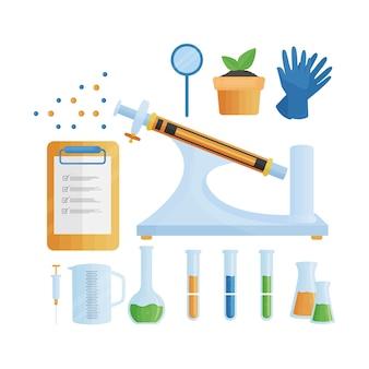 Objetos de laboratorio de ciencias y bloc de notas