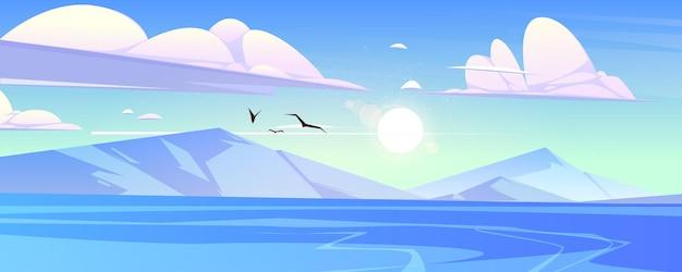 Océano o mar con montañas y gaviotas en el cielo azul