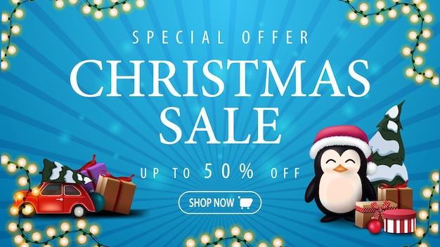 Oferta especial, venta de navidad, hasta 50 de descuento, banner de descuento azul con guirnalda