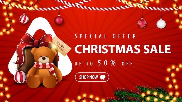 Oferta especial venta de navidad hasta 50% de descuento en banner de descuento rojo con guirnaldas