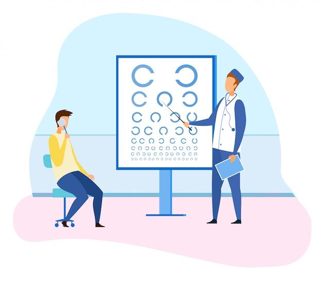 Oftalmólogo masculino que controla la vista del paciente
