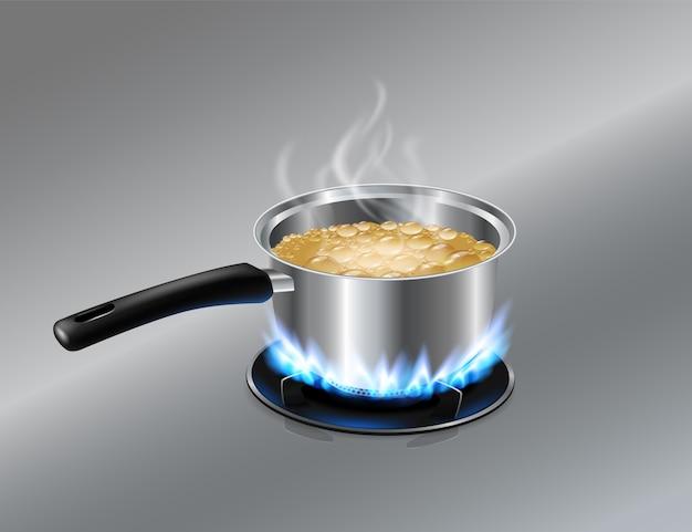 Olla de acero inoxidable olla agua hirviendo en la estufa de gas
