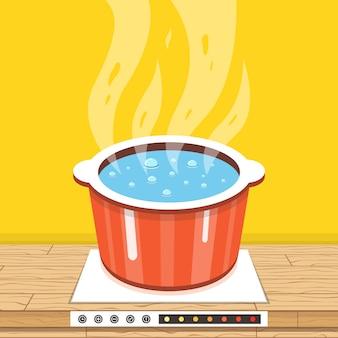 Olla en la estufa con agua y vapor