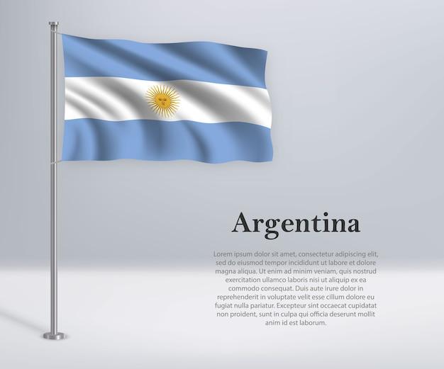 Ondeando la bandera de argentina en el asta de la bandera