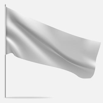 Ondeando la bandera en blanco en el asta de la bandera.