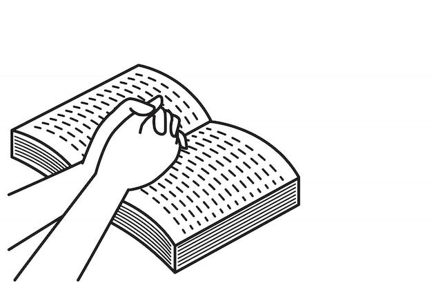 Orando con el libro de la biblia abierta