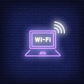 Ordenador portátil y texto de neón wi-fi.
